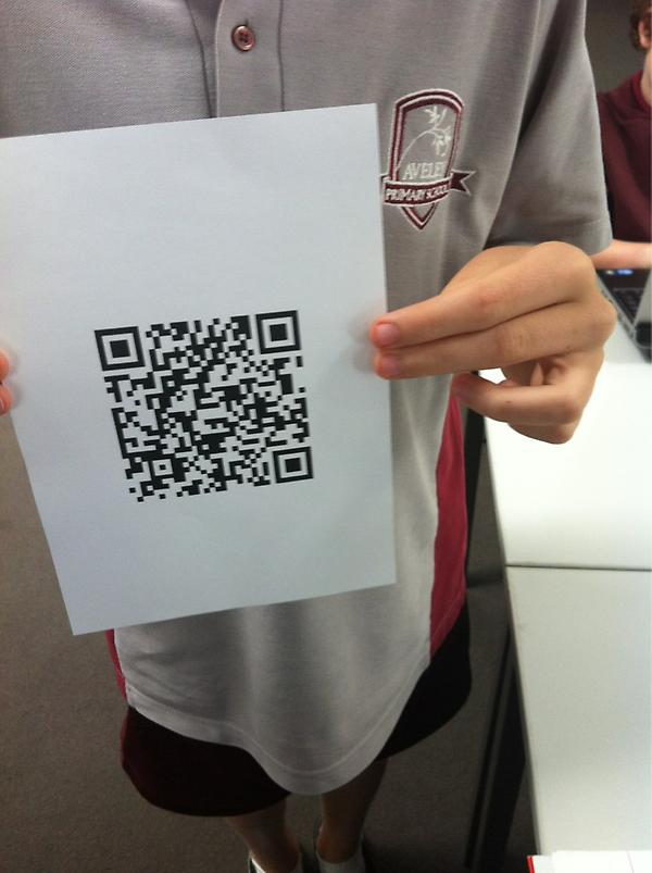 Student holding a QR code